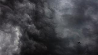 Plane flying through storm, file image