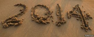 The number 2014 drawn on a beach