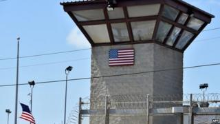 "Razor wire-topped fence and watch tower of ""Camp 6"" detention facility at Guantanamo Bay. File photo"