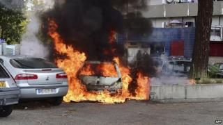 A car burns on a council estate in France in 2014
