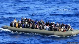 One of six makeshift boats filled with migrants which was spotted by an Italian Navy ship, in the Mediterranean sea near Lampedusa