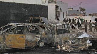 Wreckage at the scene of a car bomb attack in Mogadishu, Somalia, 4 January