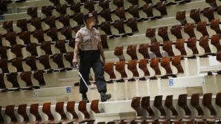 A member of Indonesian Police bomb squad searches for suspicious materials to anticipate terror attacks prior to the Christmas Eve mass at the Messiah Cathedral (Katedral Mesias) in Jakarta, Indonesia, Wednesday, Dec. 24, 2014