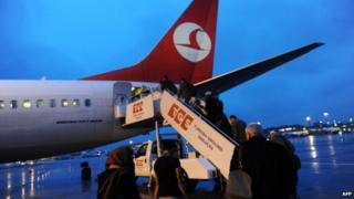 Passengers get into a Turkish Airlines aircraft in March 2013 at the Ataturk Airport in Istanbul
