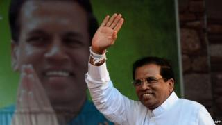 "This file photo taken on November 30, 2014 shows Sri Lanka""s main opposition presidential candidate Maithripala Sirisena waving to the crowd during an election rally in the north-central town of Polonnaruwa."