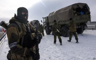 A pro-Russian rebel guards the road near the Airport of Donetsk on 6 January 2015.