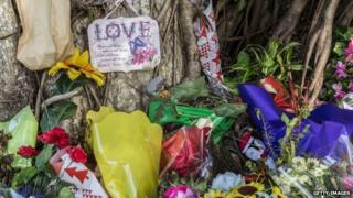 Memorials to the Cairns children near the crime scene
