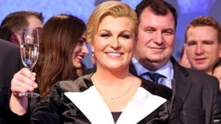 Kolinda Grabar-Kitarovic toasts next to her husband Jakov as she celebrates her win - 11 January 2015