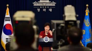 South Korean President Park Geun-hye, centre, speaks during her New Year's press conference at the presidential Blue House in Seoul Monday, 12 January 2015.