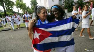 Recently released dissidents Aide Gallardo (left) and Sonia Garro hold the Cuban national flag during a march in Havana on 11 January, 2015.
