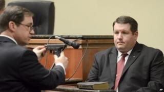 """First Circuit Solicitor David Pascoe, left, shows defendant Richard Combs the weapon he used to shoot Bernard Bailey during Combs"""" testimony, 9 January 2015"""