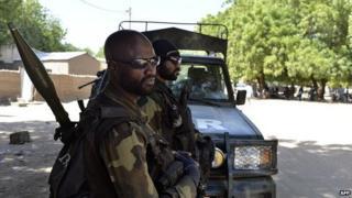 Cameroonian soldiers patrol on 12 November 2014 in Kourgui, northern Cameroon