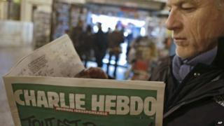 A man reads the first issue of the French magazine Charlie Hebdo since 12 people were killed in an attack on its offices (14 January 2015)