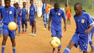 Footballers at the Cyrille Domoroud football academy in Ivory Coast