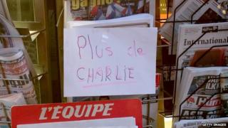 A sign at a newsstand says the latest edition of Charlie Hebdo magazine has sold out on 14 January 2015 in Paris