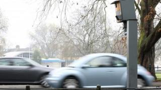 Cars passing fixed speed camera