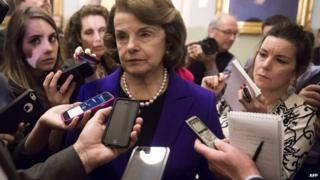 Senate intelligence committee chairwoman Dianne Feinstein speaks to reporters at the US Capitol in Washington - 9 December 2014