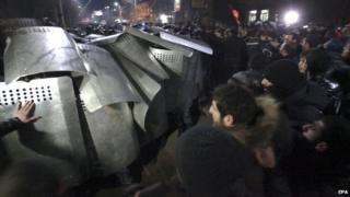 Riot police and protesters clash in Gyumri, Armenia. Photo: 15 January 2015