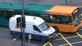 Cardiff bus and van at yellow box junction in the city centre