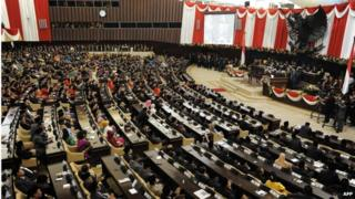 In this file picture taken on October 20, 2014, Indonesian President Joko Widodo (R) delivers his address before the members of parliament during his swearing in ceremony in Jakarta.