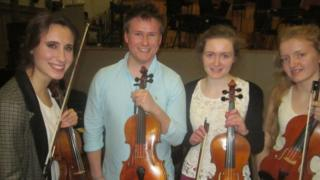 Violinist Jennifer Pike with her Belfast students Scott Lowry, Susanna Griffin and Georgia Begley