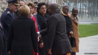 Mr Nketia alongside other officials in a receiving line in Germany