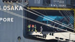 A piece of machinery is seen through rear door of the Hoegh Osaka cargo ship