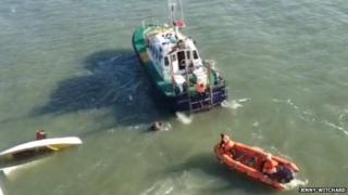 Capsized boat photographed from ferry