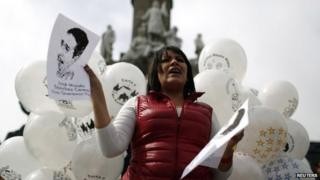 An activist holds a picture of missing journalist Moises Sanchez in Mexico City on 4 January, 2015.