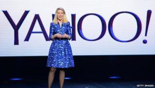 Marissa Mayer in front of Yahoo logo