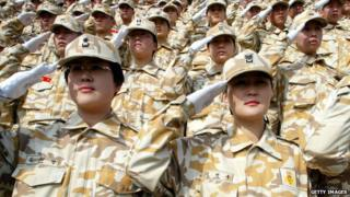 Female South Korean soldiers saluting