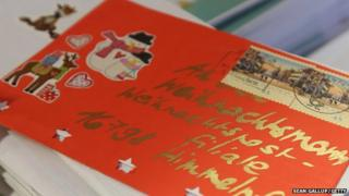 A letter to Santa lies among many others on a table at the post office on 18 November 2014 in Himmelpfort, Germany.