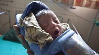 A premature baby wearing an Embrace baby warmer