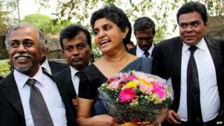 Sri Lanka's former chief justice Shirani Bandaranayake (C) arrives at the Supreme Court complex in Colombo on January 28, 2015, after new Sri Lankan President Maithripala Sirisena restored her to her position
