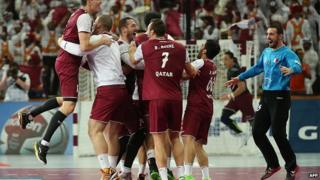 layers of the Qatari national team celebrate their win during the 24th Men's Handball World Championships quarterfinals match between Germany and Qatar at the Lusail Multipurpose Hall in Doha on January 28, 2015
