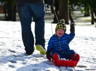 Happy little boy on sledge