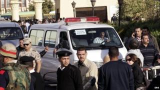 An ambulance carries the coffin of a soldier after the funeral for some of the 30 killed in Sinai attack, al-Maza military airport, Egypt, 30 January 2015.