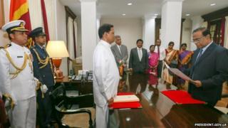 Judge Kanagasabapathy Sripavan (right) takes oath in front of President Maithripala Sirisena (centre)