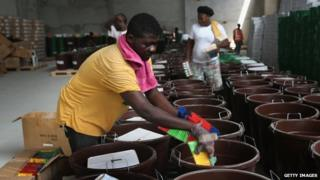 """A Unicef worker assembles """"school infection prevention kits"""" to stop the spread of Ebola in schools in Monrovia. Photo: 28 January 2015"""