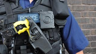 Police officer with a Taser