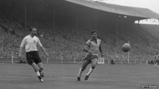 Playing for England against Brazil in 1956
