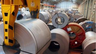 Rolls of steel being held in storage