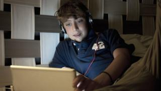 teen using a laptop