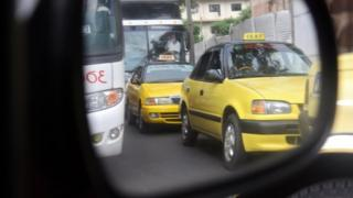 taxis in car side mirror