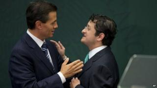 Mexican President Enrique Pena Nieto congratulates Virgilio Andrade Martinez during a press conference to announce Mr Andrade's appointment as the Secretary of Public Administration in Mexico City on 3 February, 2015