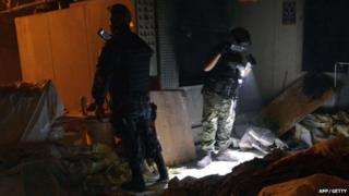 Mexican soldiers work at a private crematorium, where corpses were found in Acapulco, Guerrero State, on 6 February 2015