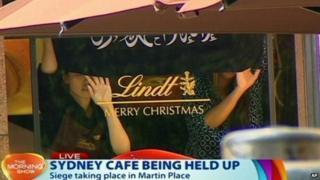 Hostages hold a banner during the Sydney cafe siege (December 2014)
