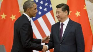 Chinese President Xi Jinping and his US counterpart, Barack Obama, shake hands at the end of their joint news conference at the Great Hall of the People in Beijing on 12 November 2014.