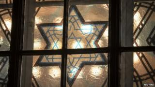 A window is pictured with the Star of David of Germany's newest synagogue in Cottbus in Germany on 27 January 2015