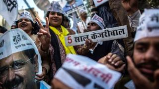AAP supporters celebrate their party's win in Delhi state elections on 10 February 2015